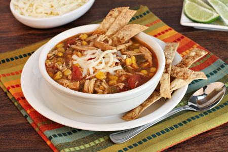 southwest: A bowl of chicken tortilla soup with homemade tortilla chips    Stock Photo
