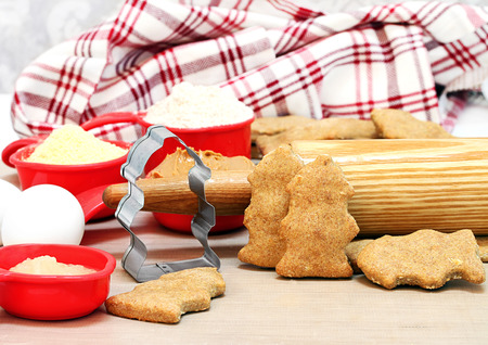 mat like: Making homemade peanut butter dog biscuits shaped like fire hydrants  Rolling pin and ingredientson a silicone mat  Stock Photo