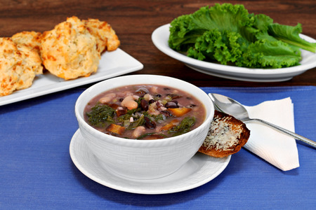 beans soup: Kale and bean soup with a side of cheesy toast. Stock Photo