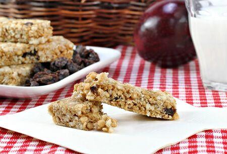 wicker bar: A healthy granola bar, raisen, apple and milk snack.