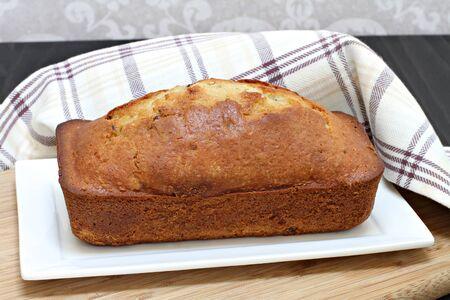 On whole freshly baked pound cake.  Unadorned, side view. Stock fotó - 44656596
