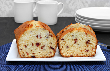 Homemade, freshly baked cranberry pound cake on a plate.  Whole portion and sliced pieces. Stock fotó