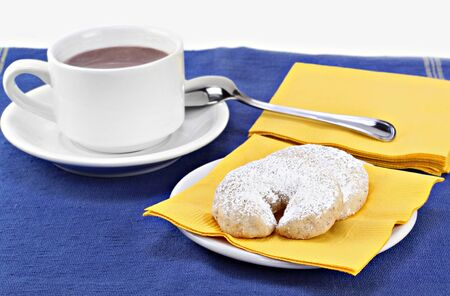 tex: Mexican wedding cookies with a cup of hot cocoa.