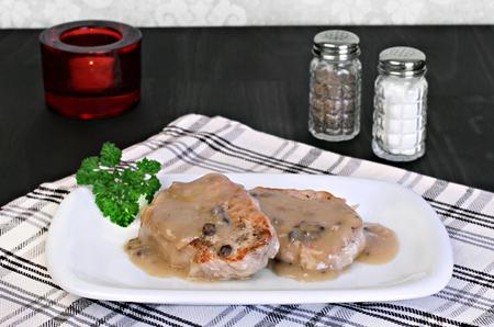 pork chops: Two baked pork chops with mushroom gravy.