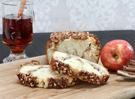 pound cake: Sliced loaf of apple cinnamon pound cake with a pecan topping.  Selective focus on sliced pieces.