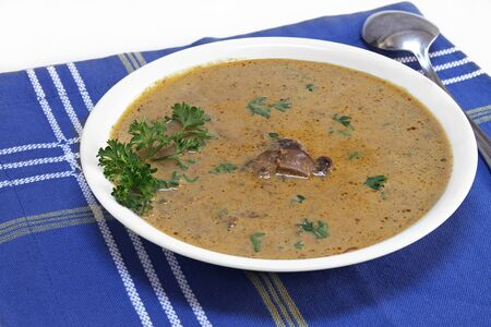 Homemade and healthy creamy mushroom soup.  Close up with copy space.