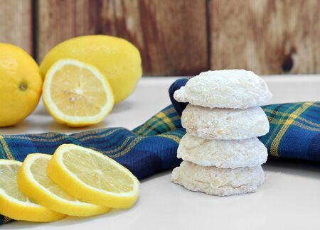 A stack of sugared lemon cookies, with whole and sliced lemons. Stok Fotoğraf