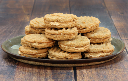 Stacked peanut butter and oatmeal cookies, with peanut butter filling.  Macro, front view image with copy space. Stock Photo
