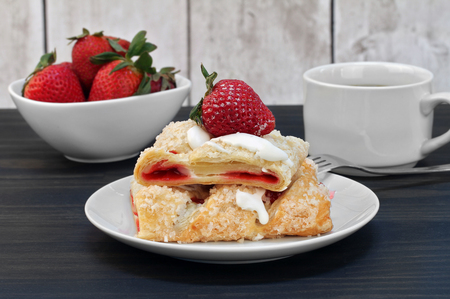 Sliced strawberry cheese strudel with fresh strawberries. Stok Fotoğraf