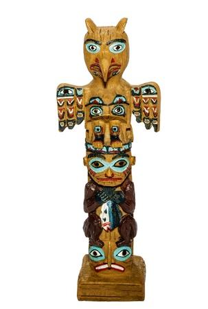 wood figurine: Totem Pole isolated on white background