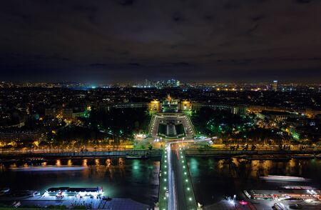The night view of Paris city from the top of Eiffel tower photo