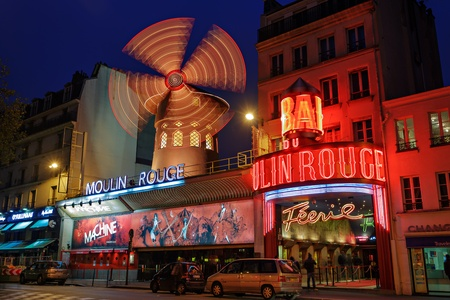 moulin: PARIS - NOV 12  The Moulin Rouge by night, on November 12, 2012 in Paris, France  Moulin Rouge is a famous cabaret built in 1889, locating in the Paris red-light district of Pigalle
