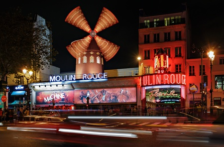rouge: PARIS - NOV 12  The Moulin Rouge by night, on November 12, 2012 in Paris, France  Moulin Rouge is a famous cabaret built in 1889, locating in the Paris red-light district of Pigalle