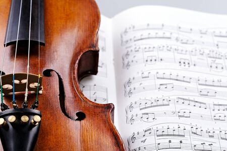 Old violin with notes Stock Photo - 17970223