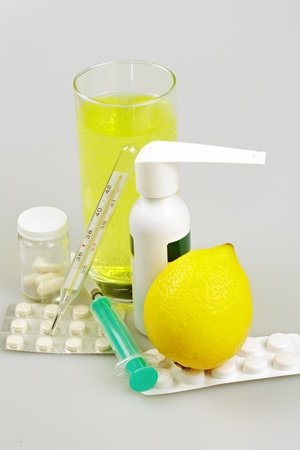 Medical supplies, tablets and capsules, spray throat and drink, lemon photo