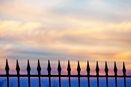 metaphorical: A fence against a golden sunset