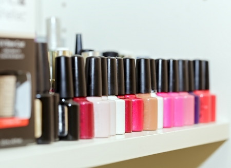Nail polishes on shelf in beauty salon photo