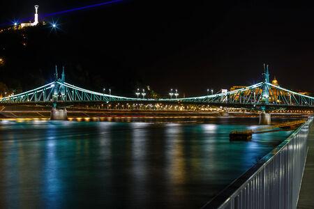 danuba: The Freedom bridge in Budapest Hungary by night. Stock Photo