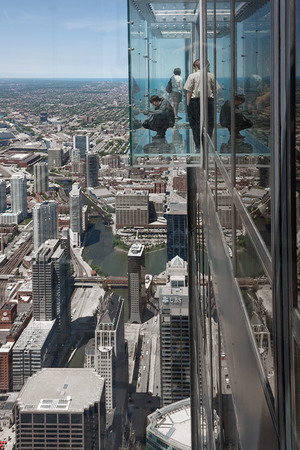 CHICAGO, USA - JUNE 3, 2010:  Tourist in The Ledge, glass balconies in 103th floor of the Sears Tower in Chicago