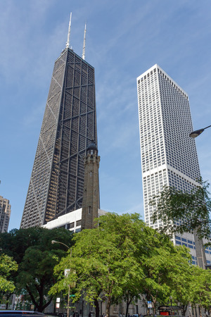 magnificent mile: CHICAGO, USA - JUNE 4, 2010: Johnncock  Habuilding on Michigan Ave (Magnificent Mile) in Chicago was in 1968 the tallest building outside of New York. It stands next to Water Tower Place Editorial