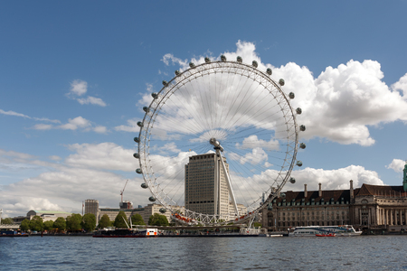 LONDON, ENGLAND - MAY 12, 2014: View of the London Eye. London Eye (135 m tall, diameter of 120 m) - a famous tourist attraction over river Thames in the capital city London.