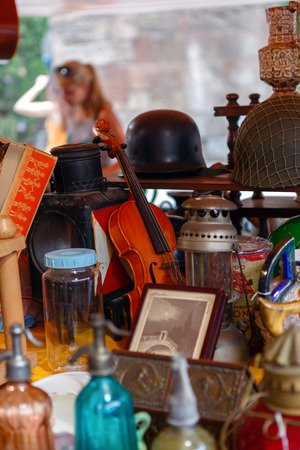 second meal: Barcelona, Spain - June 12, 2014: Vintage things for sale on an outdoor flea market in Barcelona.