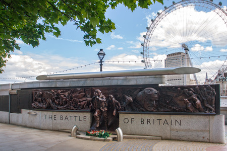 owed: LONDON, UK - 12 May, 2014: The Battle of Britain Memorial. 25m-long bronze monument commemorating the pilots who died during WWIIs Battle of Britain Editorial