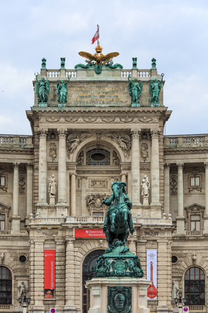 hofburg: VIENNA, AUSTRIA - JUNE 27, 2015: Statue of Prince Eugene and facade of Neue Burg in Hofburg Palace. Editorial