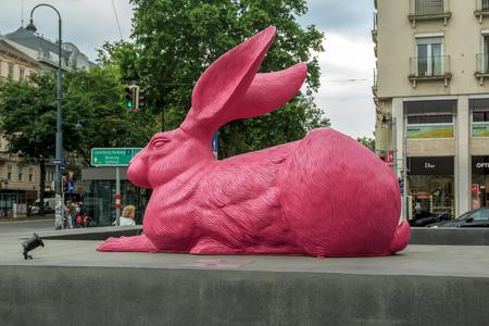 durer: VIENNA, AUSTRIA - JUNE 27, 2015: Pink bunny sculpture near State Opera in Vienna. Made by the German concept artist Ottmar Horl