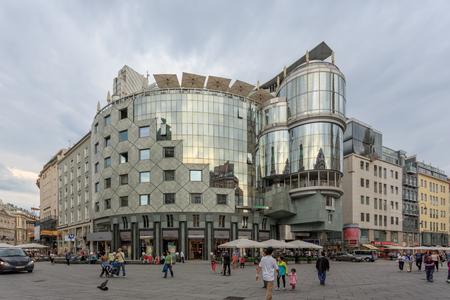 stephansplatz: VIENNA, AUSTRIA - JUNE 27, 2015: Haas-Haus on Stephansplatz in Vienna. Building was designed by architect Hans Hollein in the postmodernist style