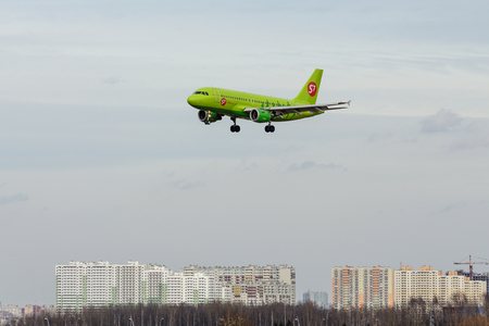 SAINT PETERSBURG, RUSSIA - APRIL 09, 2017: Flying the Airbus A319-100 (VP-BTU) airline S7 - Siberia Airlines Editorial
