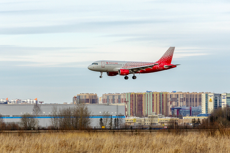 SAINT PETERSBURG, RUSSIA - APRIL 09, 2017: Flying the Airbus A319-100 (EI-EZD) airline Rossiya - Russian Airlines