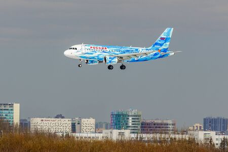 SAINT PETERSBURG, RUSSIA - APRIL 19, 2017: Flying the Airbus A319-111 (VQ-BAS) airline «Rossiya - Russian Airlines» in the color of the football club Zenith. The plane goes on landing at Pulkovo airport.