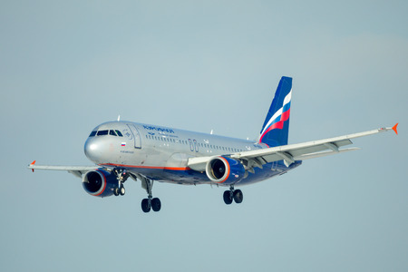 SAINT PETERSBURG, RUSSIA - APRIL 19, 2017: Flying the Airbus A320-214 (VP-BZR) airline «Aeroflot - Russian Airlines». Aircraft name «F. Bellinsgauzen». The plane goes on landing at Pulkovo airport.