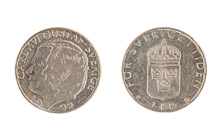 Set of commemorative the Swedish coin, the nominal value of 1 kronor, from 1992, shows a portrait Carl XVI Gustaf. King of Sweden. Isolate on white background