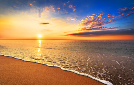 beach panorama: Beautiful tropical sunrise on the beach. Stock Photo
