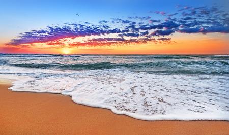 Colorful ocean beach sunrise. Stok Fotoğraf - 49114314