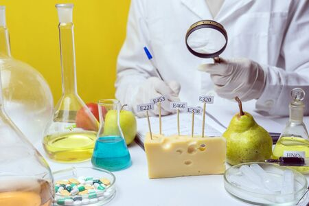 Food safety laboratory procedure, lab assistant analysing fruits from the market Stock Photo