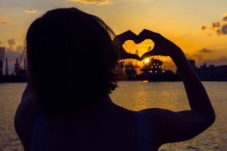 Girl in love enjoying tender moments at sunset during holiday with best friends. Emotional concept of happy exclusive lifestyle moment, sharing time, relaxing with nature contact Фото со стока