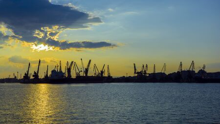 Colorful sunset over sea port and industrial cranes, Varna, Bulgaria Banco de Imagens