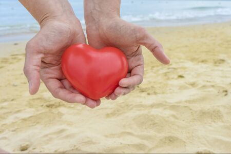 Two Hand holding The Heart shape on white background.Love Concept .Copy space for text.Clipping path