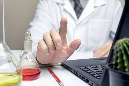 Close up of male doctor or medical student in lab pointing finger hand. health and education concepts Stock Photo