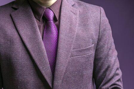 Man in elegant custom tailored expensive suit. Close up