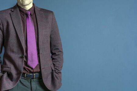 Close up of businessman in purple suit confident on blue background Stock Photo