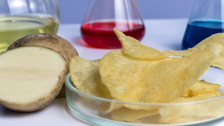 Food safety laboratory procedure, analysing potato chips from the market. Workplace lab assistant.