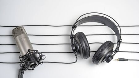 music studio background with headphones and microphone