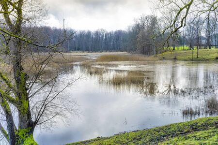 Late autumn in Latvia, Dundaga. Park with a beautiful lake near the old castle.