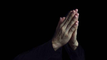 Man Praying Hands in black background