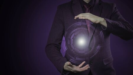 photo a businessman in a suit and tie with outstretched hand for implementation of graphic futuristic. Concept: business, graphic, holography, digital.