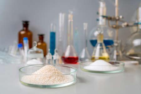 Photo Sport Nutrition Supplement in lab. Creatine powder and amino BCCA on lab background Standard-Bild
